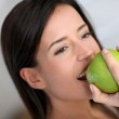 Portrait of woman eating an apple — Stock Photo