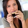 Portrait of beautiful woman drinking espresso - Stock Photo