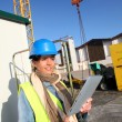 Architect on building site using electronic tablet — Stock Photo #13934835