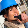 Site manager using walkie-talkie on building site — Stock Photo