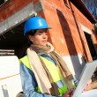 Architect on building site using electronic tablet — Stock Photo #13934838