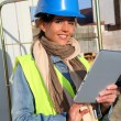 Architect on building site using electronic tablet — Stock Photo #13934839