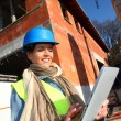 Architect on building site using electronic tablet — Stock Photo #13934841
