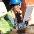 Architect on building site using electronic tablet — Stock Photo #13934846