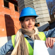 Architect on building site using electronic tablet — Stock Photo #13934847