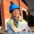 Architect on building site using electronic tablet — Stock Photo #13934854