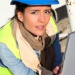 Architect on building site using electronic tablet — Stock Photo #13934857