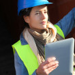 Architect on building site using electronic tablet — Stock Photo #13934860