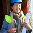 Woman architect standing on construction site — Stockfoto