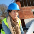 Architect on building site using electronic tablet — Stock Photo #13934870