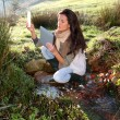 Woman scientist and environmental issues — Stock Photo