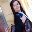 Young woman walking in town — Stock Photo #13934971