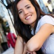 Portrait of beautiful smiling woman in town — Stock fotografie