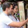 Stock Photo: Couple in Paris looking at restaurant menu