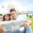Couple in Paris sitting in front of Sacre Coeur Basilica - Stock Photo