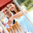 Couple in park eating ice cream cones — Stock Photo #13935686