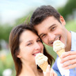 Couple in park eating ice cream cones — Stock Photo #13935689