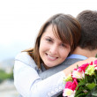 Portrait of cheerful woman who just received flowers — Stock Photo #13935765