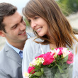 Portrait of romantic man giving flowers to woman — Stock Photo #13935772