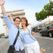 Stock Photo: Cheerful couple on Champs Elysees Avenue