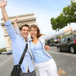 Cheerful couple on the Champs Elysees Avenue - Stock Photo