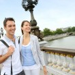 Couple in Paris walking on the bridge Alexander the Third — Stock Photo #13935805