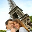 Couple embracing each other in front of the Eiffel tower — Stock Photo #13935854