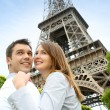Couple embracing each other in front of the Eiffel tower — Stock Photo #13935863