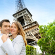 Couple embracing each other in front of the Eiffel tower — Stock Photo #13935864