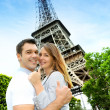 Couple embracing each other in front of the Eiffel tower — Stock Photo #13935865