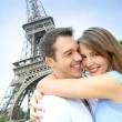 Romantic couple kissing by the Eiffel Tower — Stock Photo #13935894