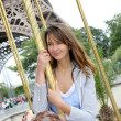 Beautiful woman sitting on a carousel in Paris — Stock Photo