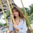 Beautiful woman sitting on a carousel in Paris - Stock Photo