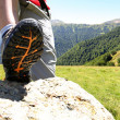Closeup of trekking shoe with mountain landscape — Foto Stock