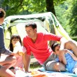 Stock Photo: Family doing camping in the forest