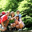 Stock Photo: Family on bridge in mountain observing nature