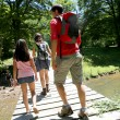 Back view of family walking on a bridge — Stock Photo