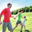 Happy family enjoying and running together in the mountains — Stock Photo #13936980