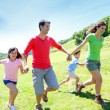 Happy family enjoying and running together in the mountains — Stock Photo