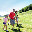 Happy family enjoying and running together in the mountains — Stock Photo #13936989
