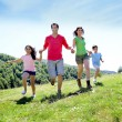 Happy family enjoying and running together in the mountains — Stock Photo #13937003