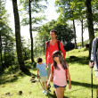 Family having fun on a trekking day — Stock Photo #13937037