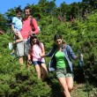 Family on a hiking day going down hill — Stock Photo #13937057