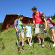Parents and kids on a trekking day in the mountain — Stock Photo