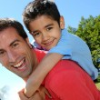 Portrait of father and son having fun in the mountain - Foto Stock