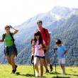 Family on a trekking day in the mountains — Stock Photo #13937186