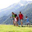 Family on a trekking day in the mountains — Stock Photo #13937190