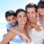 Closeup of happy family at the beach — Stock Photo