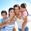 Closeup of happy family at the beach — Stock Photo