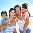 Closeup of happy family at the beach — Stock Photo #13937221